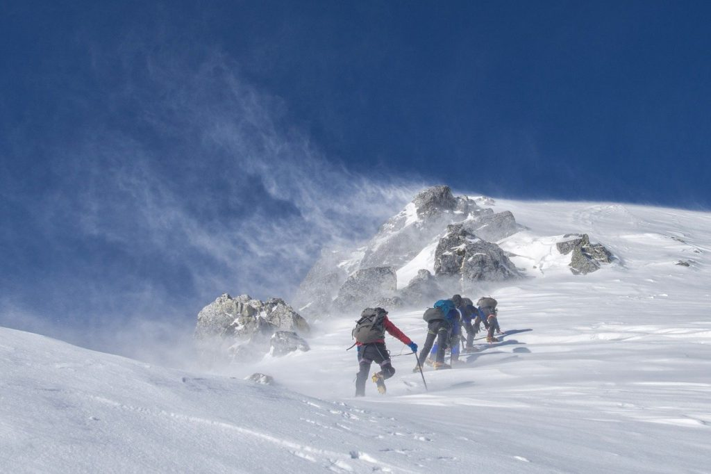 team of mountain climbers in snow