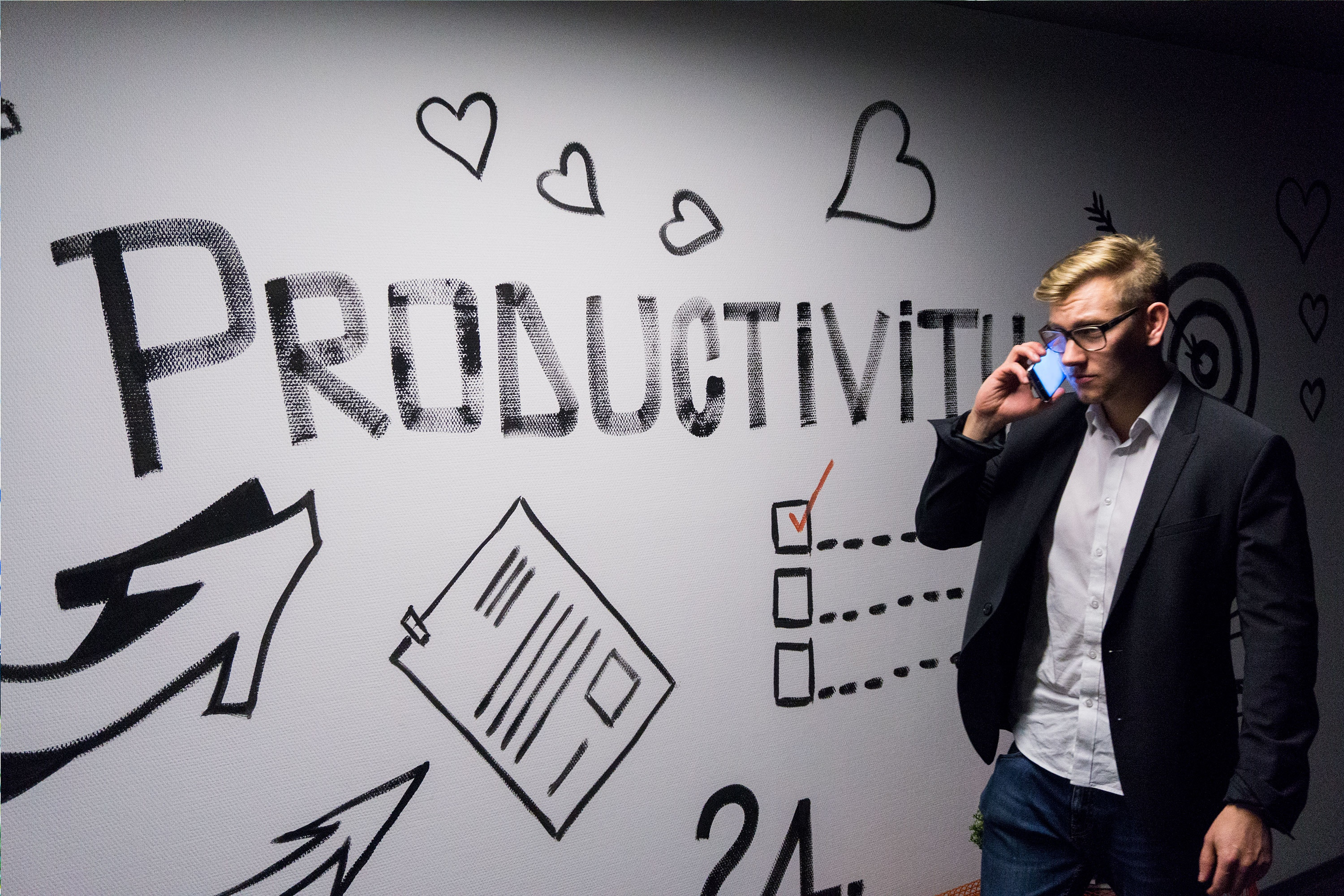 Busy leader in front of white board with productivity