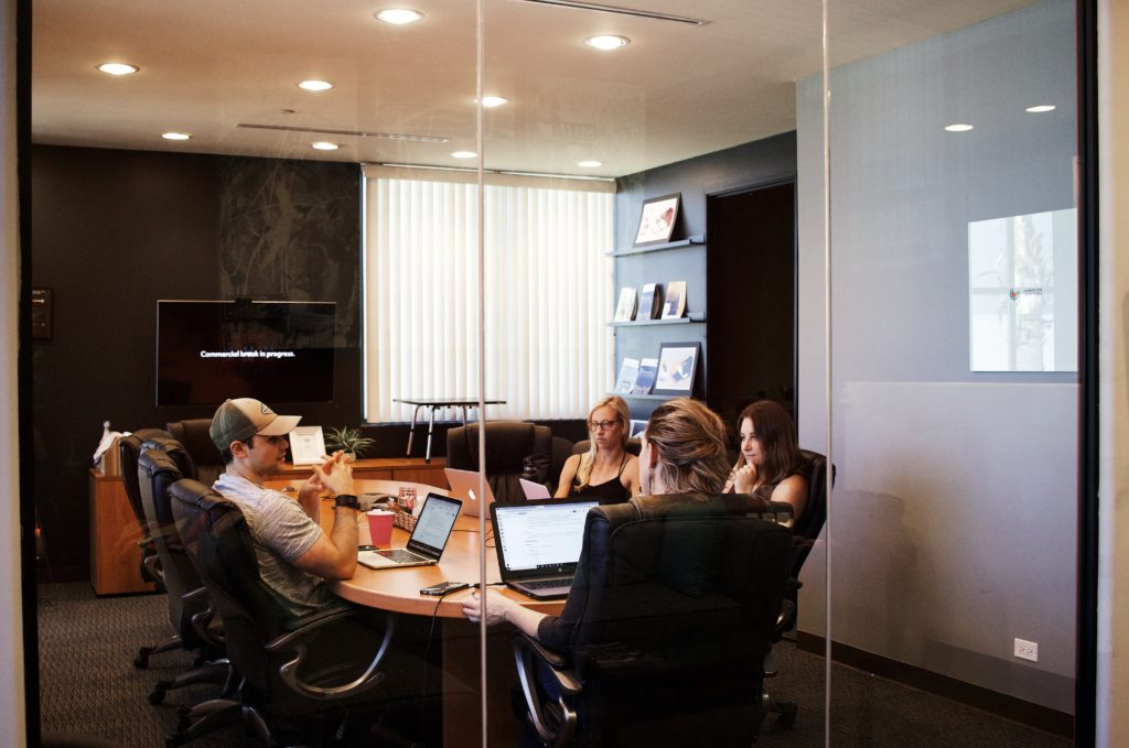 Group meeting in conference room talking about delegation of tasks