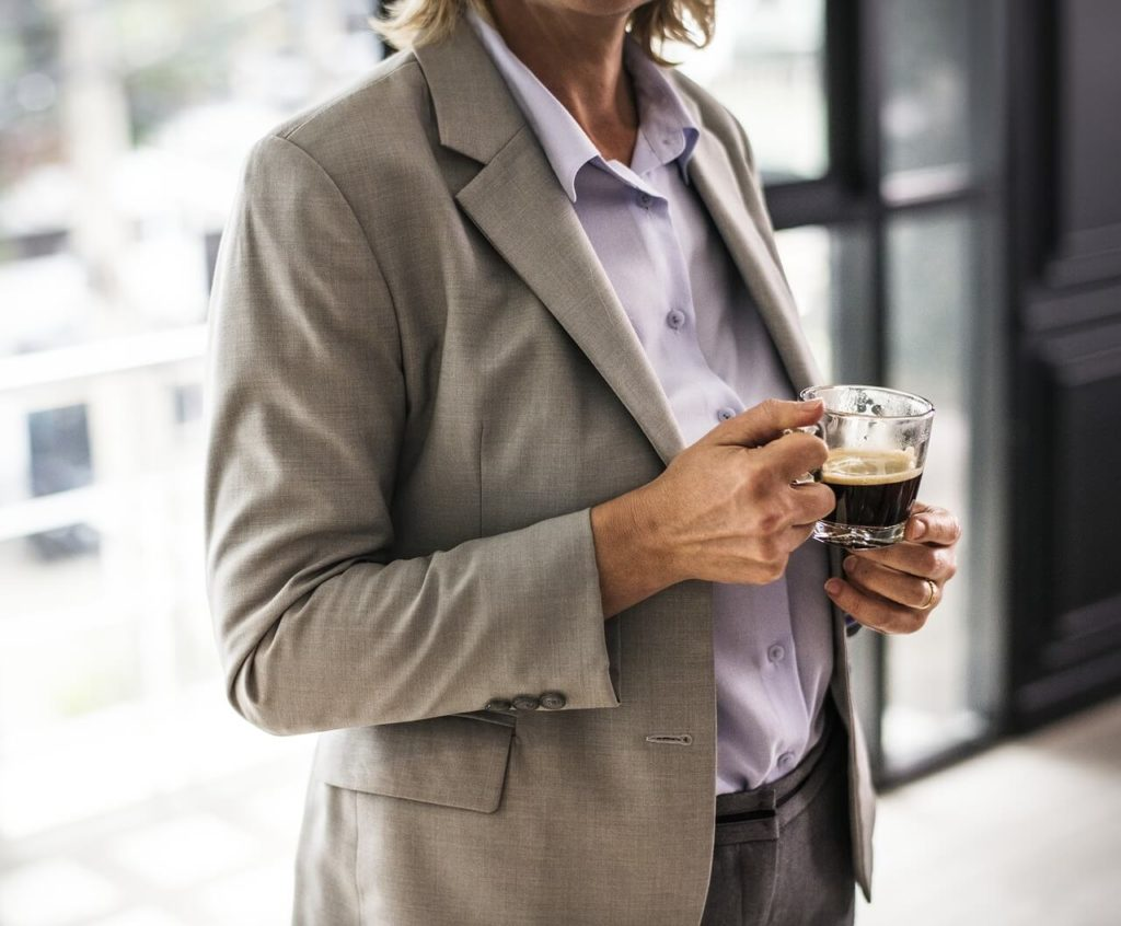 Woman business leader drinking coffee in cafe
