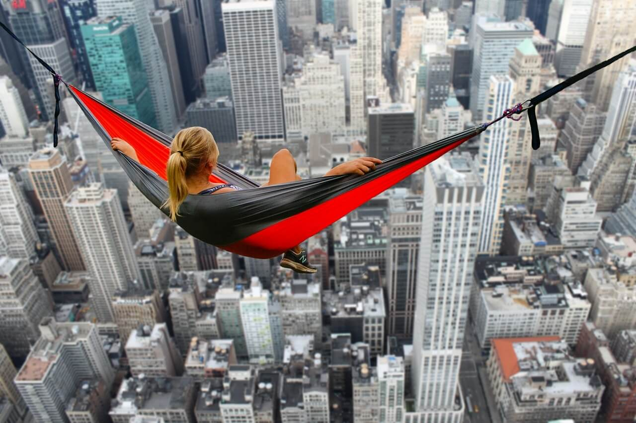 Woman swinging in hammock above Hong Kong