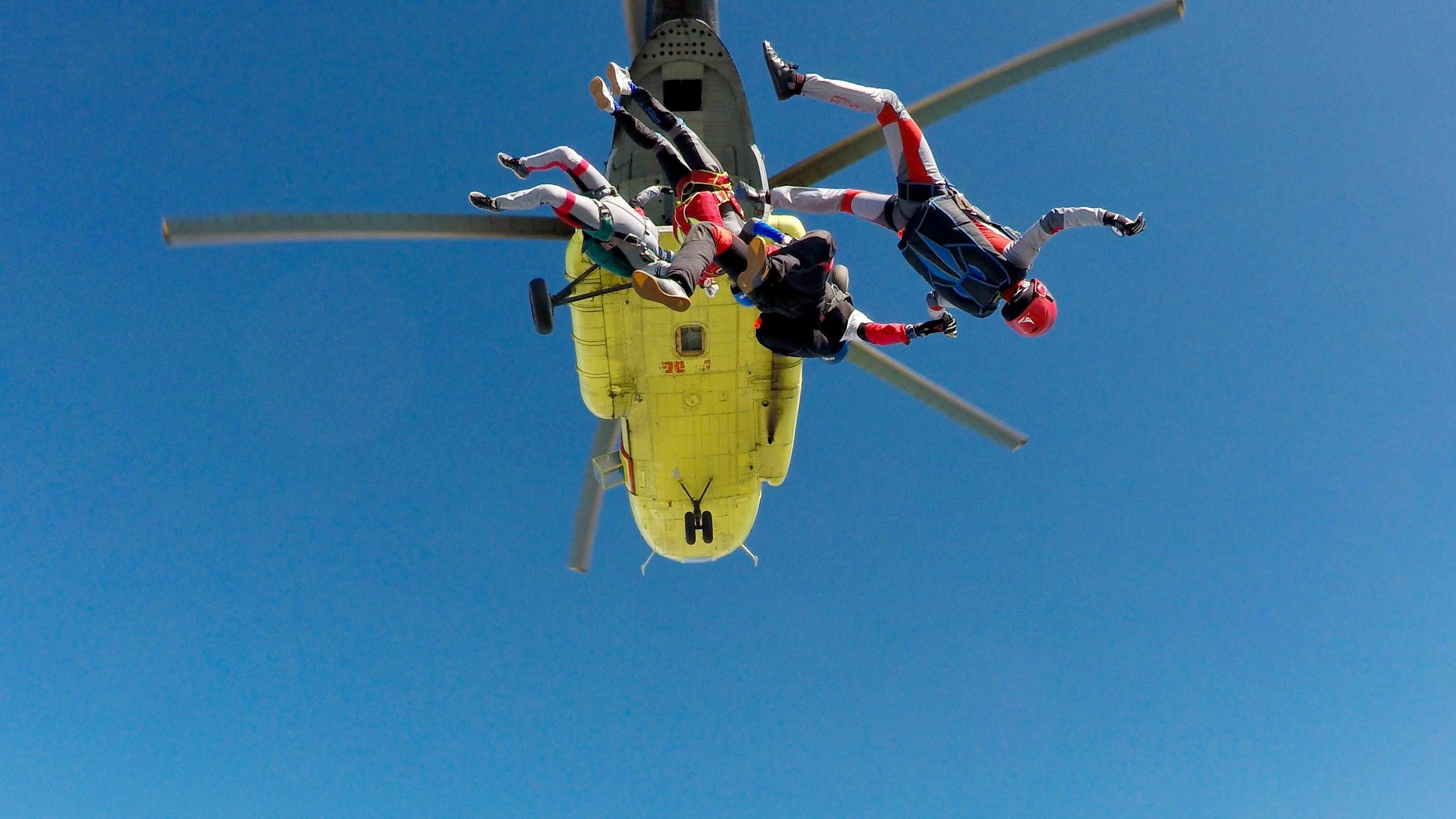 3 people skydiving