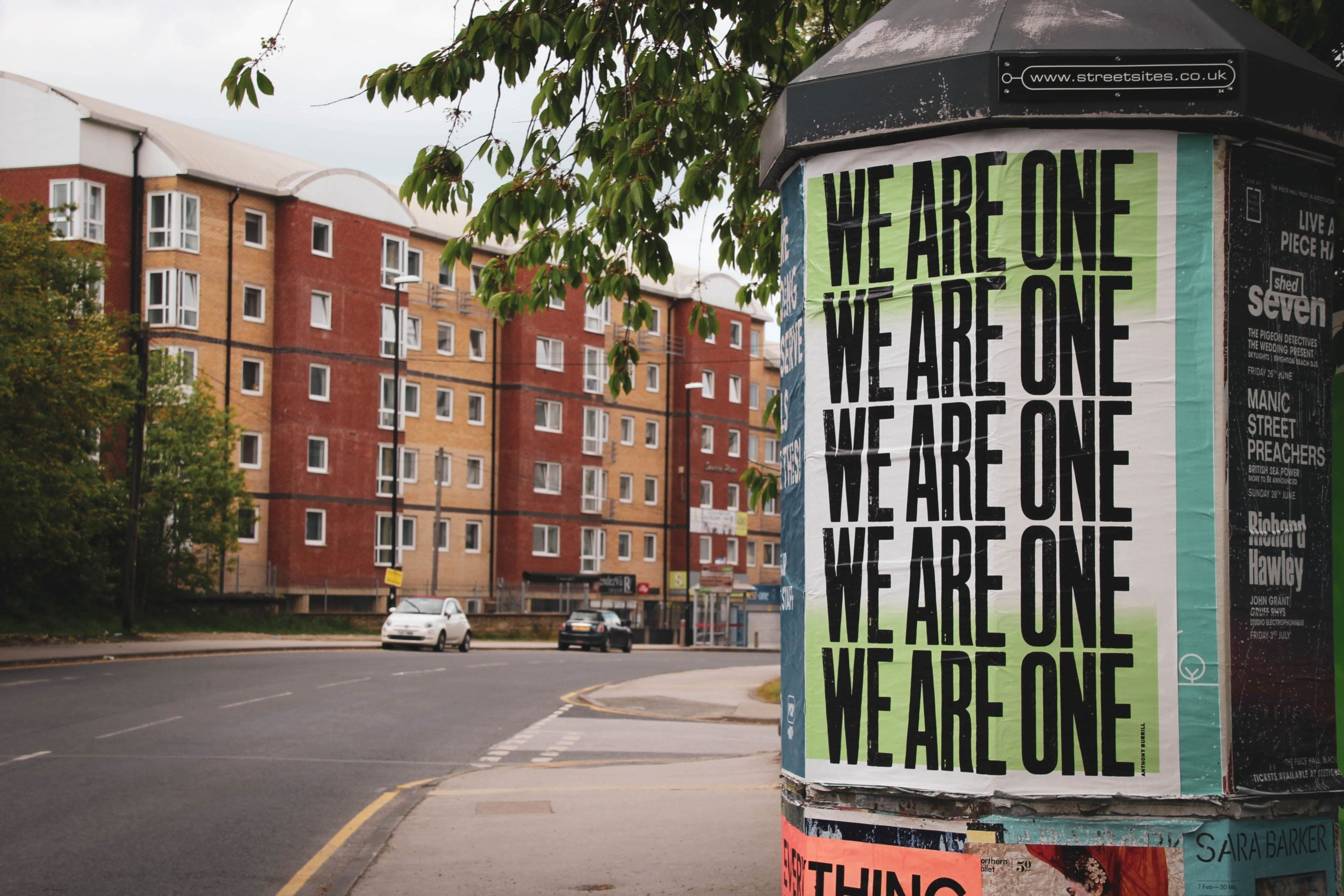 lampost sign that reads we are one