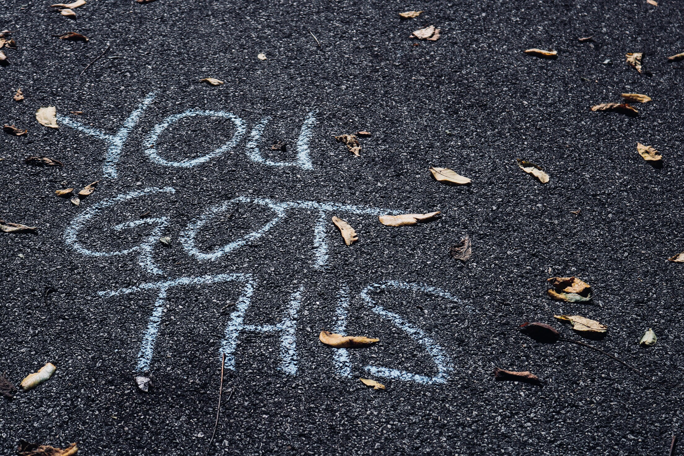 The words you got this written in chalk on street asphalt
